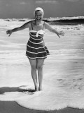 Woman Standing in Shallow Water at Ocean Photographic Print