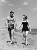 Young Couple Walking on Beach Photographic Print