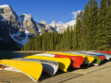 Moraine Lake and Rental Canoes Stacked, Banff National Park, Alberta, Canada Photographic Print by Larry Ditto