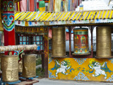Tibetan Buddhist Prayer Wheels at Shuzheng Village, Sichuan Province, China Photographic Print by Charles Crust