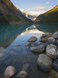 Rocky Mountains and Boulders Reflected in Lake Louise, Banff National Park, Alberta, Canada Photographic Print by Larry Ditto