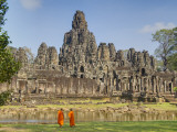 Monks Looking at Bayon Temple, Angkor, Siem Reap, Cambodia Photographic Print