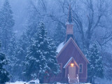 Historic Yosemite Valley Chapel During Heavy Snowfall in Yosemite National Park, California, USA Photographic Print by Chuck Haney