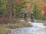 Mountain Bikers on the Slickrock of Dupont State Forest in North Carolina, USA Photographic Print by Chuck Haney