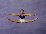 Male Gymnast Performing on the Floor Exercises Photographic Print