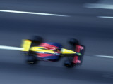 Blurred F1 Auto Racing Action Photographic Print