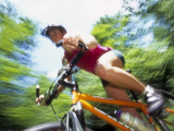 Young Female Recreational Mountain Biker Riding in the Forest Photographic Print