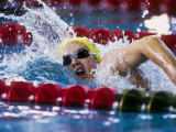Female Swimmer Competing in a Race Photographic Print