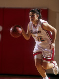 High School Girls Basketball Player in Action Photographic Print