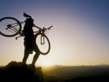 Silhouette of Mountain Biker at the Summit During Sunrise Photographic Print