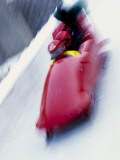 Blurred Action of 4 Man Bobsled Team at the Start Photographic Print