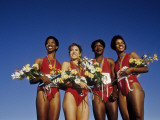 Track and Field Womens Relay Team on the Podium with their Gold Medals Photographic Print
