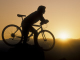 Silhouette of Mountain Biker at the Summit During Sunrise Fotoprint