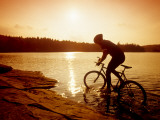 Silhouette of Mountain Biker at Sunset Photographic Print