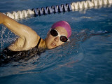 Female Swimmer Exercising in a Pool Photographic Print