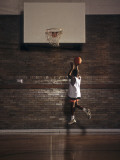 Young Boy Practicing his Basketball Shooting Photographic Print