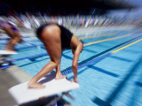 Female Swimmer at the Start of a Race Photographic Print