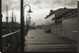 San Francisco Pier with Incoming Fog Reproduction transférée sur toile par Christian Peacock