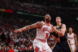 Indiana Pacers v Chicago Bulls - Game Two, Chicago, IL- April 18: Carlos Boozer and Tyler Hansbroug Photographic Print