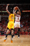 Indiana Pacers v Chicago Bulls - Game Five, Chicago, IL- April 26: Derrick Rose and Paul George Photographic Print