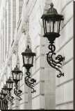 Lamps on Side of Building Stretched Canvas Print by Christian Peacock