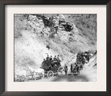 Procession of Stagecoaches Coming down Mountain Road Photograph - Deadwood, SD Posters
