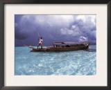 Bajau Fisherman in Traditional Lepa Boat with Rain Clouds Behind, Pulau Gaya, Borneo, Malaysia Prints by Jurgen Freund