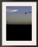 Skydiver Landing at Sunset, USA Prints by Michael Brown