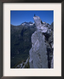 Climber on the Summit of a Rock Tower, Chile Print by Pablo Sandor