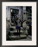 A Fisherman on His Doorstep, Indonesia Prints by Michael Brown