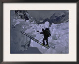 Climbing Across Ladder on Everest, Nepal Prints by Michael Brown