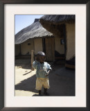 Child by Straw Hut, South Africa Prints by Ryan Ross