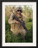 Saqlawiyah, Iraq, a Combat Engineer Assumes a Kneeling Position as He Provides Security in a Field Posters by  Stocktrek Images