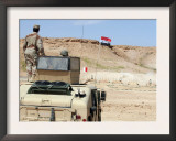 An Instructor Watches an Iraqi Army Soldier in the School of Infantry Fire a Pkc Machine Gun Print by  Stocktrek Images