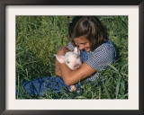 Girl Holding Domestic Piglet, Mixed Breed, USA Prints by Lynn M. Stone