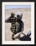 A Marine Handles a String of 40 mm High-Explosive Grenades Poster by  Stocktrek Images