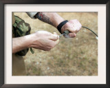 A Soldier Pulls a Detonation Cord Igniter to Start a Reaction Detonating C-4 Explosives Prints by  Stocktrek Images