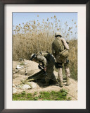 Marines Search Around an Iraqi Home North of Hit, Iraq, March 9, 2007, for Weapons Caches Posters by  Stocktrek Images
