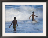 Two Boys Playing in the Surf on the Beach, Manakara Town, East Coast of Madagascar Prints by Inaki Relanzon