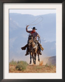 Cowboy Running with Rope Lassoo in Hand, Flitner Ranch, Shell, Wyoming, USA Poster by Carol Walker
