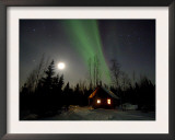 Cabin under Northern Lights and Full Moon, Northwest Territories, Canada March 2007 Art by Eric Baccega