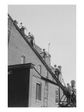 A Team of Firefighters With Hoses on Their Backs Climbs a Ladder Posters