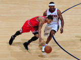 Chicago Bulls v Atlanta Hawks - Game Six, Atlanta, GA - MAY 12: Derrick Rose and Joe Johnson Photographic Print by Scott Cunningham