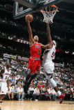 Chicago Bulls v Atlanta Hawks - Game Three, Atlanta, GA - MAY 6: Derrick Rose and Josh Smith Photographic Print by Scott Cunningham