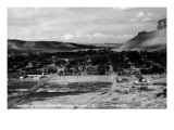 Green River, Wyoming - Panoramic View of Town with Castle Rock Posters by  Lantern Press