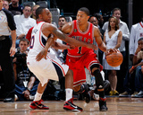 Chicago Bulls v Atlanta Hawks - Game Three, Atlanta, GA - MAY 6: Jeff Teague and Derrick Rose Photo by Kevin Cox