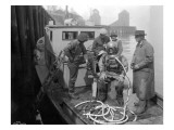 Inspecting the Piles at Tacoma, Diver on Deck in Suit, 1924 Giclee Print by Asahel Curtis