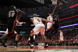 Miami Heat v Chicago Bulls - Game One, Chicago, IL - MAY 15: Dwyane Wade and Derrick Rose Photographic Print by Jonathan Daniel