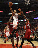 Jonathan Daniel - Miami Heat v Chicago Bulls - Game Two, Chicago, IL - MAY 18: Derrick Rose and Udonis Haslem - Photo