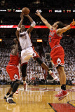 Chicago Bulls v Miami Heat - Game Four, Miami, FL - MAY 24: Chris Bosh, Joakim Noah, Luol Deng Photographic Print by Mike Ehrmann